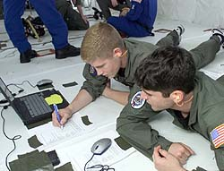 Students working on computers on the KC-135