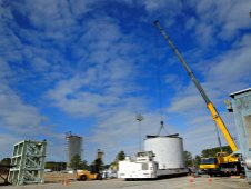 A massive test article moves into location at the Marshall Center Engineering Test Laboratory in preparation for a Shell Buckling Knockdown Factor test.