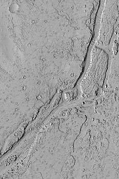 This February 2003 Mars Global Surveyor Mars Orbiter Camera picture shows a valley in the Phlegra Dorsa region of Mars.