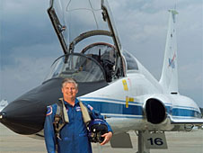 Charlie Justiz standing in front of a T-38 airplane