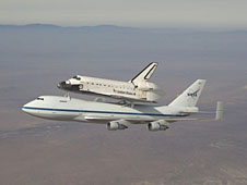 The space shuttle orbiter atop another aircraft in midair