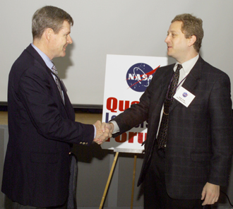 NASA Associate Administrator for Safety and Mission Assurance shakes hands with his counterpart from the Department of Defense Missile Defense Agency. Photo credit: NASA JSC/Mike Gentry.