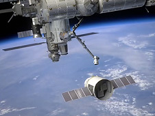 Artist's concept of a SpaceX Dragon capsule preparing to dock with the International Space Station