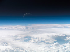 Earth's atmosphere is the thin blue line that fades into the darkness of space in this image taken by an astronaut on the International Space Station