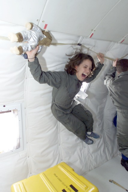 Unidentified student floats weightless in the four-engine KC-135 as part of NASA's Reduced Gravity Student Flight Opportunities Program. Photo credit: NASA/Johnson Space Center.