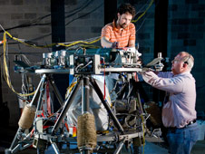 NASA Marshall engineer Josh Moore and Teledyne Brown Engineering avionics engineer Scott Gilley prepare the robotic lander prototype for tests at the U.S. Army Redstone Arsenal Test Center in Huntsville.