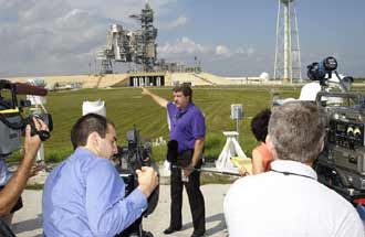Robert Page, chair of the NASA Intercenter Photo Working Group, briefs news media on the improved tracking cameras that will be used to capture ascent imagery during the return to flight of the Space Shuttle.