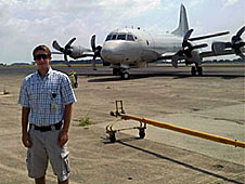 Kyle Lewis in front of the P-3 Orion