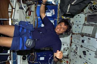 Astronaut Franklin Chang-Diaz floats with his CD player during the STS 91 mission.