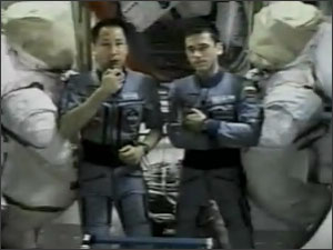 Via NASA TV, Expedition 7 Science Officer Edward Lu (left) and Commander Yuri Malenchenko react enthusiastically to the news of China's first manned launch.