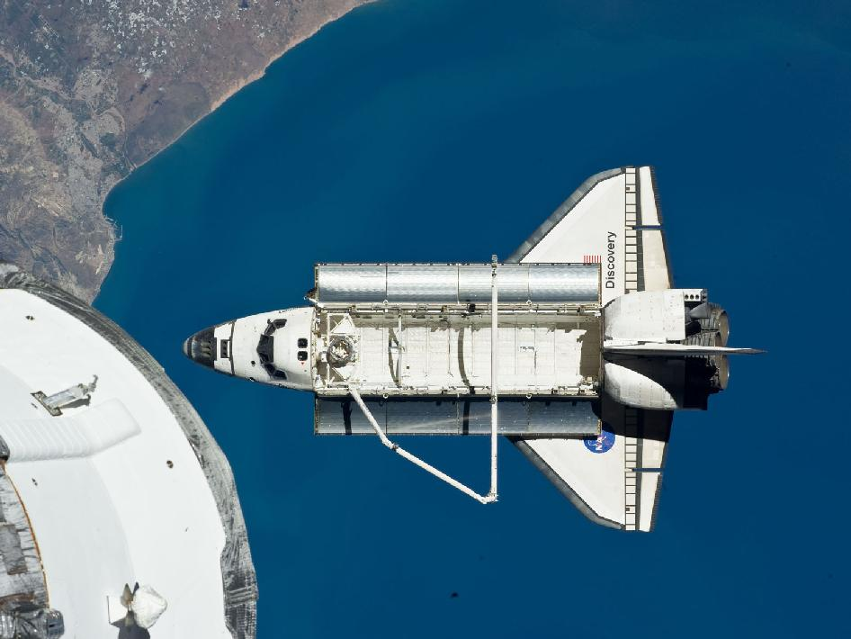 Space shuttle Discovery in space.