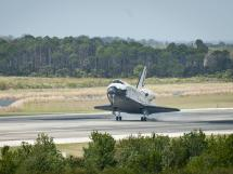 Space shuttle Discovery lands.