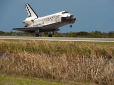 Space shuttle Discovery touches down.