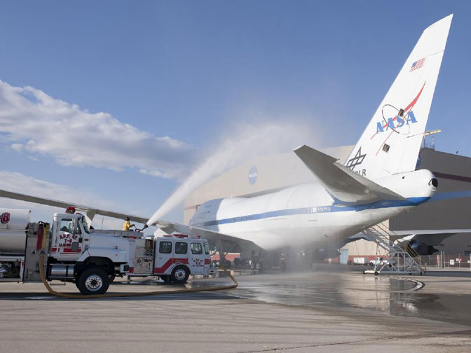 The Stratospheric Observatory for Infrared Astronomy, or SOFIA, 747 is bathed by water from the Air Force Plant 42 fire department outside the Dryden Aircraft Operations Facility in Palmdale, Calif., during recent leak checks.