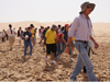 Dr. Chris McKay walking with students in UAE