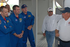 George Hoggard teaches astronauts procedures.