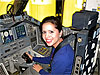 Stefanie Gonzalez inside a space shuttle simulator