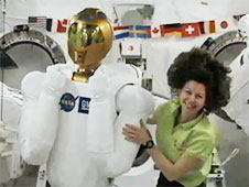 Catherine Coleman poses with Robonaut 2