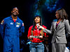 Leland Melvin with a student and Trinesha Dixon