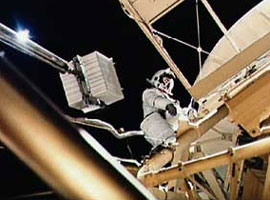 Astronaut Owen Garriott participates in an EVA to deploy the twin pole solar shield.