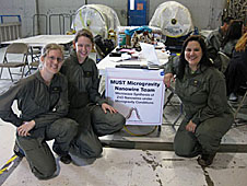 Hannah Clevenson, Olivia Lenz and Tanya Miracle in a hangar