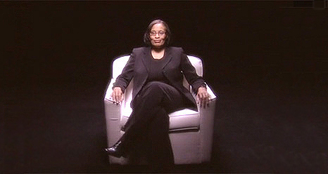 Dovie Lacy sitting in a white chair.