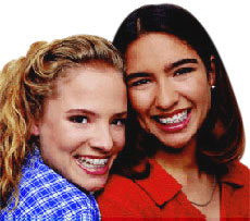 Two girls wearing clear braces