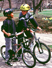 Kids wearing safety helmets for bike riding
