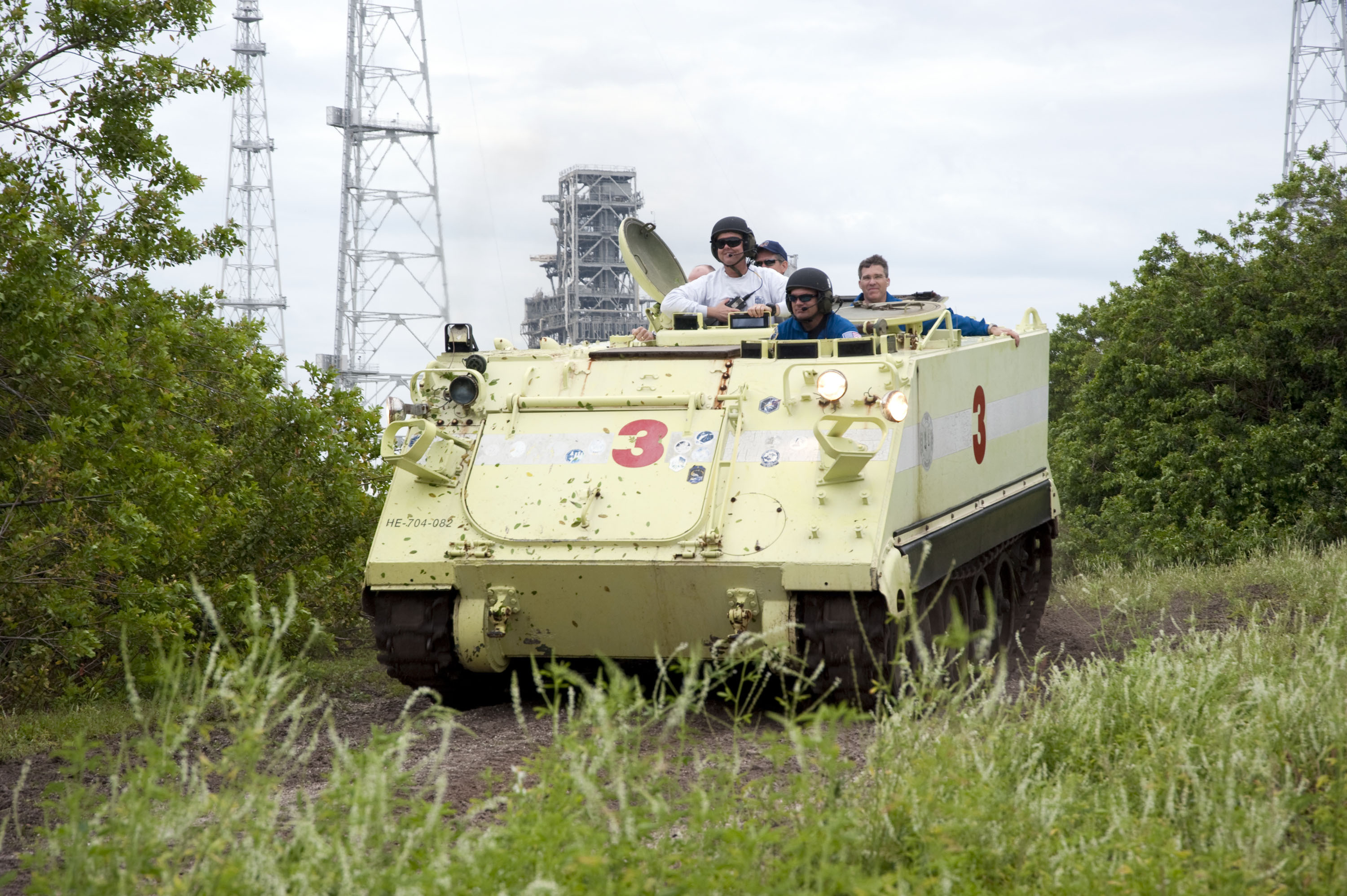 NASA - M113s Give Armored Ride to Firefighters
