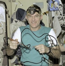 Astronaut James Voss uses a soldering iron onboard the International Space Station.