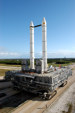 The Mobile Launcher Platform carries a set of solid rocket boosters down the KSC crawlerway during a vibration test.