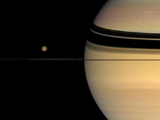 Saturn and four of its moons