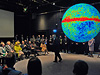 NASA's Ed Weiler uses the Science on a Sphere exhibit to make a presentation to Queen Elizabeth