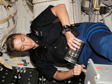 Astronaut Heidemarie M. Stefanyshyn-Piper, STS-115 mission specialist, works with the Group Activation Packs (GAP) on the middeck of Space Shuttle Atlantis.