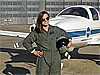 Rebecca Kollmeyer stands in front of a small aircraft