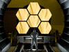 NASA engineer Ernie Wright looks on as the first six flight ready James Webb Space Telescope's primary mirror segments are prepped to begin final cryogenic testing at NASA's Marshall Space Flight Center in Huntsville, Ala.