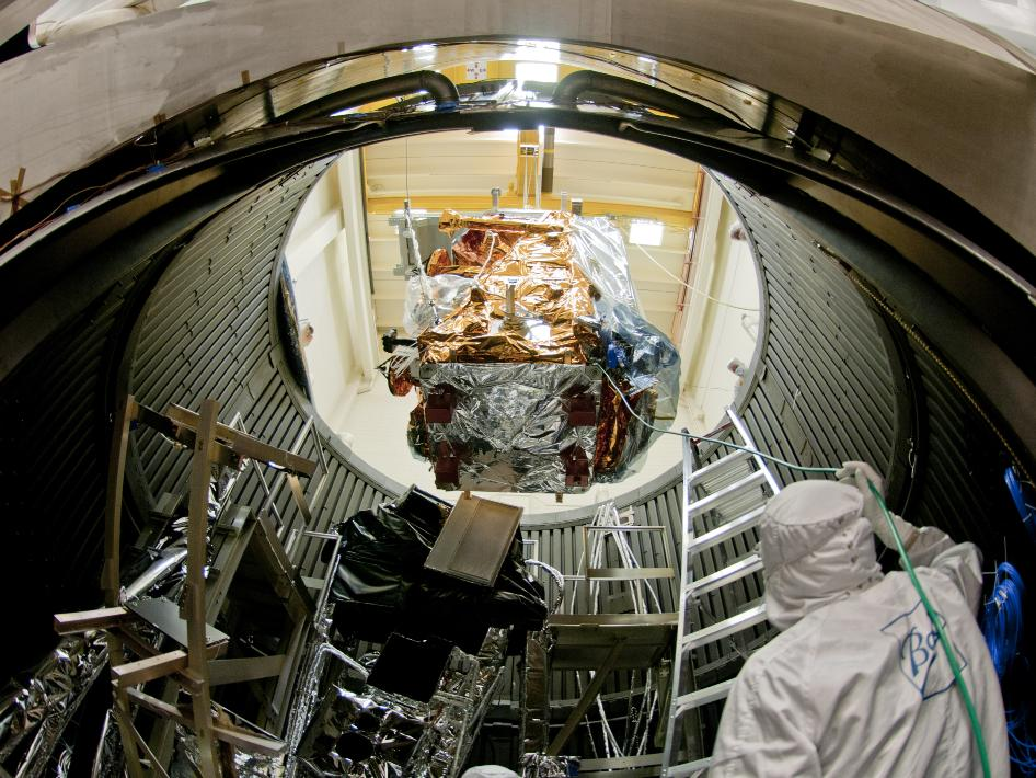 NPP being lowered into thermal vac chamber