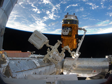 ISS026-E-033204 -- The Kounotori2 H-II Transfer Vehicle In the grasp of Canadarm2
