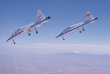 A pair of T-38s perform a simulated shuttle landing.