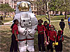 Students and a large inflatable astronaut