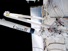 STS100-396-007 -- Astronaut Scott E. Parazynski works with cables associated with the Space Station Remote Manipulator System or Canadarm2