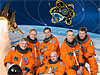 The STS-134 crew in orange launch and entry suits