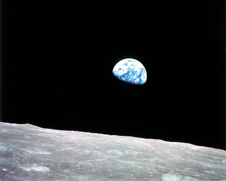a pale blue Earth rising above the Lunar horizon