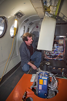 Crew chief Scott Sims installs instrumentation on NASA's B200 aircraft