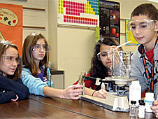 Students work with lab equipment