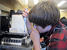 A student uses lab equipment