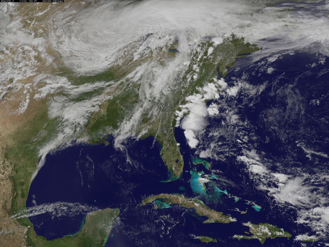 The GOES-13 Satellite captured a visible image of the system today as daytime heating was boiling up strong and severe thunderstorms.