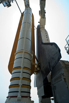 The arms that reach out to the shuttle at the launch pad.