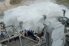Water pours onto the pad surface during a system test.