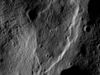 Intricate fault patterns enhanced by dawn lighting in Seares crater